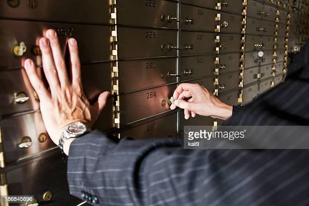 Man opening safety deposit box