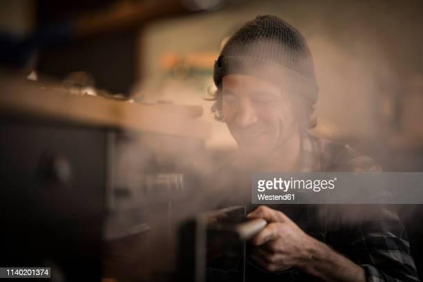man opening steaming oven in his kitchen - leidenschaft stock-fotos und bilder