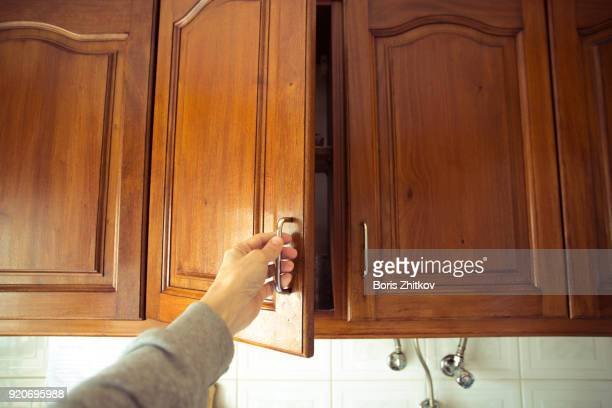 Man opens the cabinet door