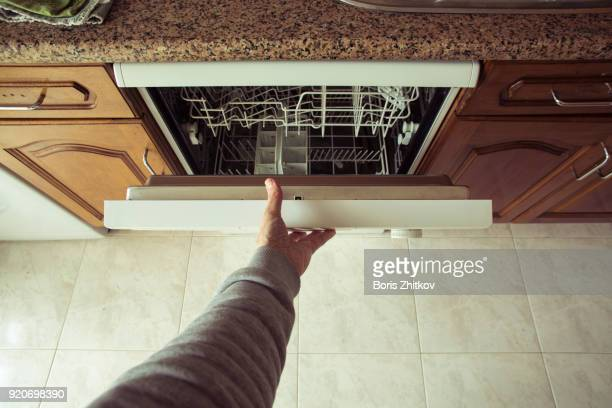 Man opens the dishwasher