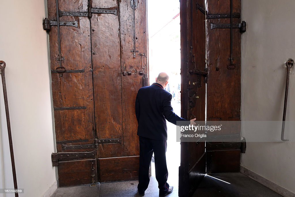 A man opens the main door of the Apostolic Palace of Castelgandolfo on February 20, 2013 in Rome, Italy. The Apostolic Palace and The Pontifical Villas of Castelgandolfo, 10 miles south Rome, are the summer residence of Popes and will host Pope Benedict XVI during the next conclave.
