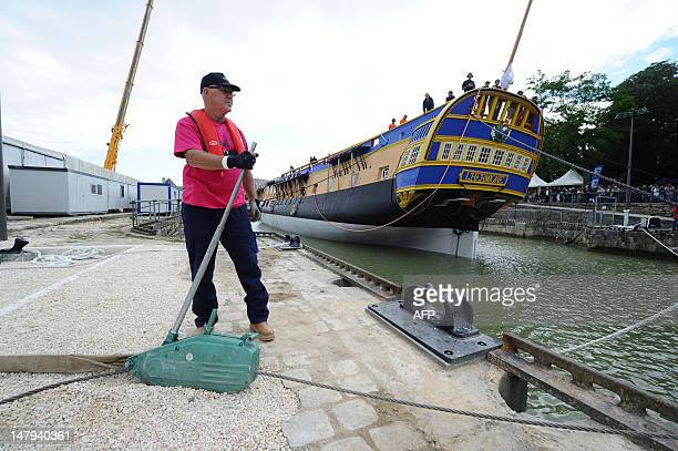 A man operates a lever during the launching ceremony of the replica of the Hermione the frigate on which La Fayette embarked in 1780 on July 6 2012...