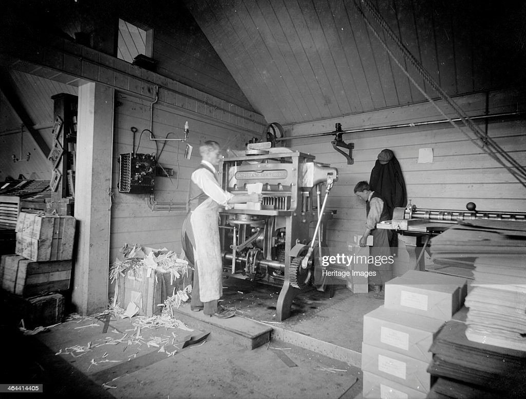A man operates a printing press at the Church Army Press, Oxford, Oxfordshire, c1860-c1922.