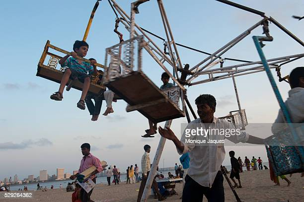 A man operates the manual swing on Chowpatty beach of children Locals and tourists visit Chaowpatty Beach in Mumbai Traditionally the site of the...
