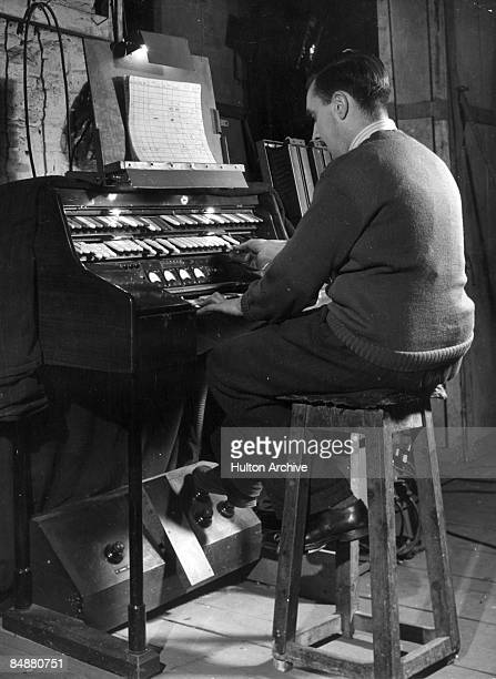 A man operating a portable Strand Electric Light Console at the Theatre Royal in Bristol later the Bristol Old Vic circa 1946 The console designed by...