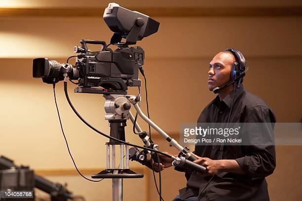 A Man Operating A Tv Camera