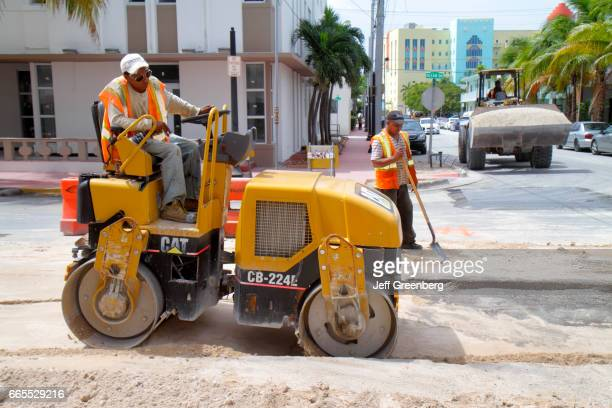 A man operating a Vibratory Asphalt Compactor on Ocean Drive