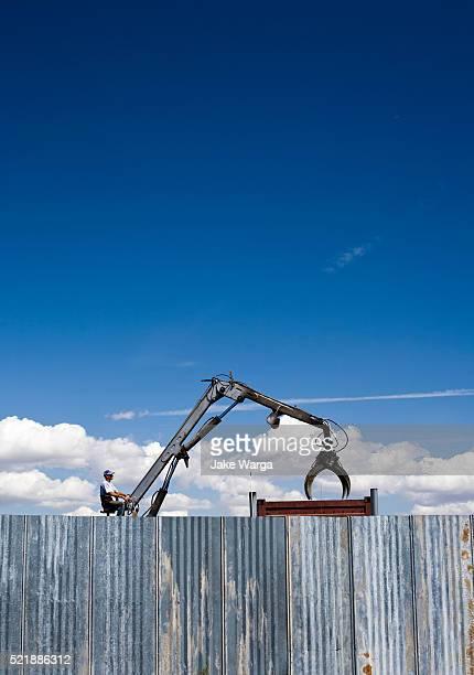 man operating crane in junk yard - jake warga stock pictures, royalty-free photos & images