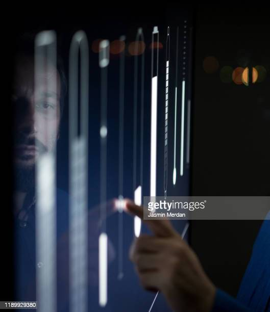 man operating in control room moving sliders on screen - human body part stock pictures, royalty-free photos & images