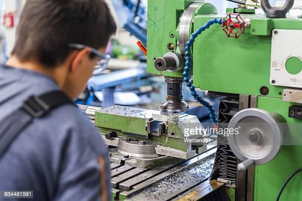 Man operating milling machine