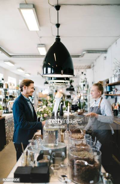 man ordering cake at cozy café - northern european stock photos and pictures