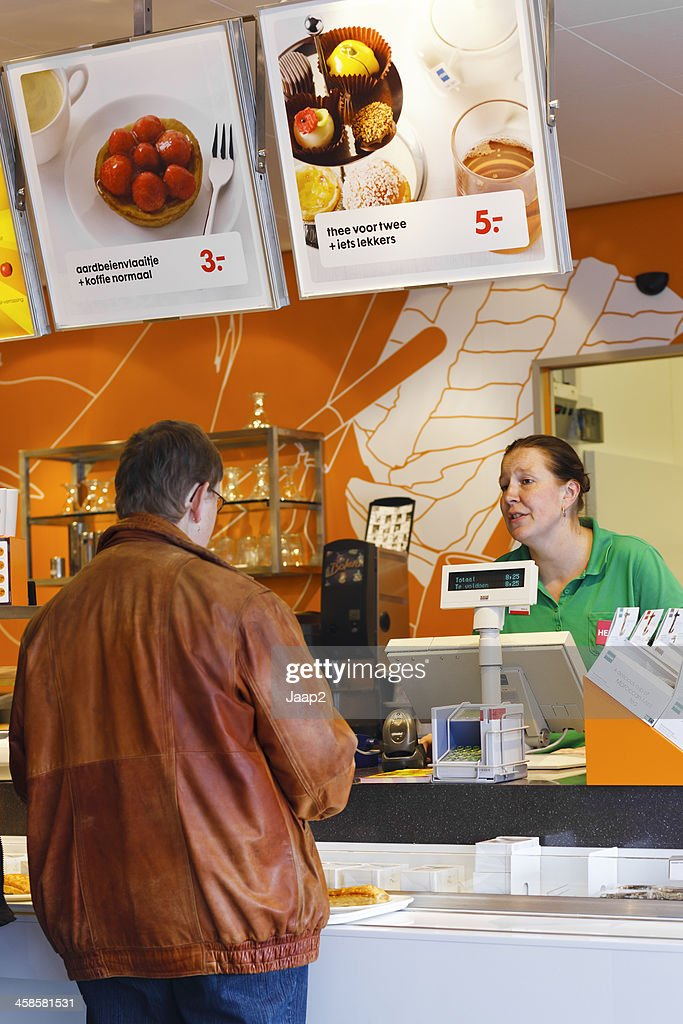 Man Ordering Coffee At Counter In Dutch Hema Department