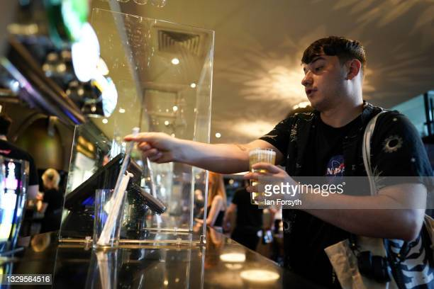 Man orders a drink from the bar in the Mile Castle pub on Freedom Day on July 19, 2021 in Newcastle upon Tyne, England. As of 12:01 on Monday, July...