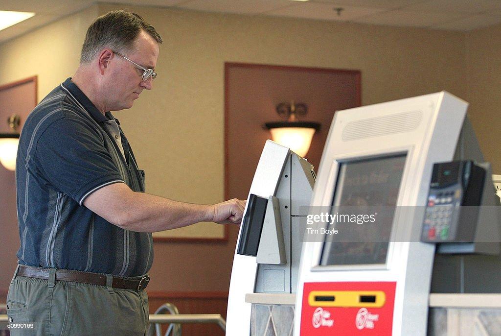 McDonald's Introduces Self-Service Kiosks : News Photo