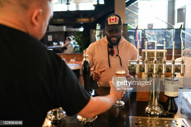 Man orders drinks from the bar in the Mile Castle pub on Freedom Day on July 19, 2021 in Newcastle upon Tyne, England. As of 12:01 on Monday, July...