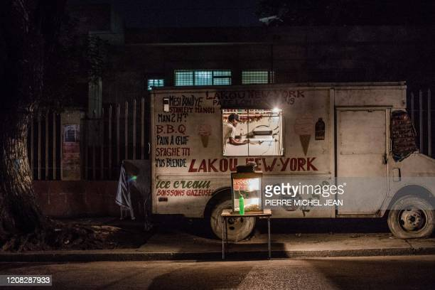 A man organizes a food truck in downtown PortauPrince on March 26 2020 On March 19 President Jovenel Moise announced a halt to all air travel after...