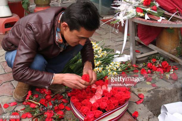 A man organizes flowers at a souvenir shop on Valentine's Day in Kabul Afghanistan on February 14 2018