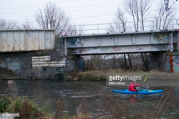 Man out canoeing on the Worcester and Birmingham Canal in Birmingham United Kingdom The Worcester and Birmingham Canal is a canal linking Birmingham...
