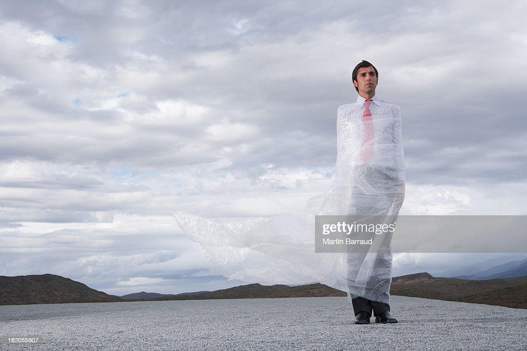 Man outdoors ensnared in a sheer sheet : Stock Photo