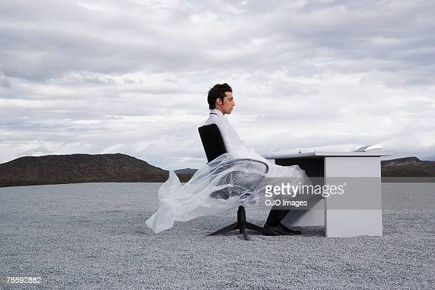 man outdoors ensnared in a sheer sheet - man tied to chair stock photos and pictures