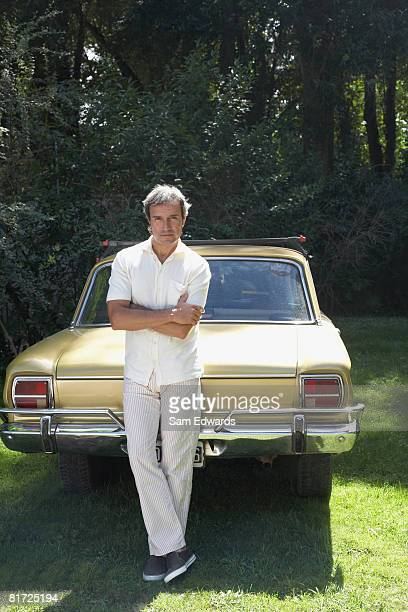 Man outdoors leaning on car
