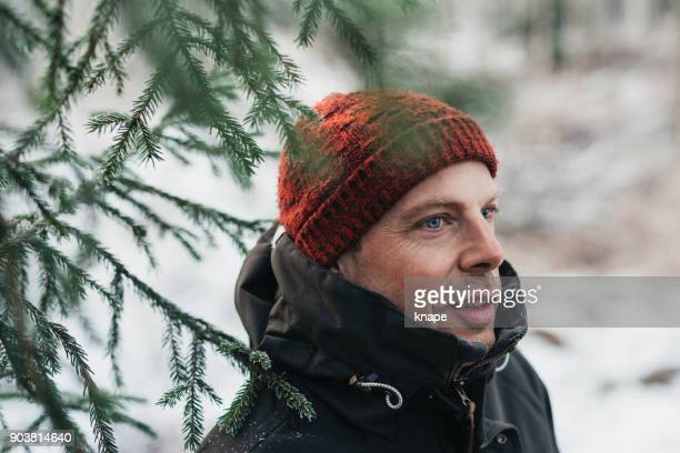 man outdoors on cold frosty winters day - one man only stock pictures, royalty-free photos & images