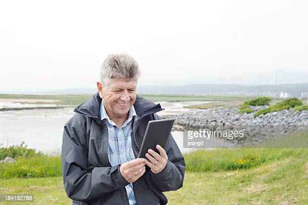 Man outdoors with digital tablet