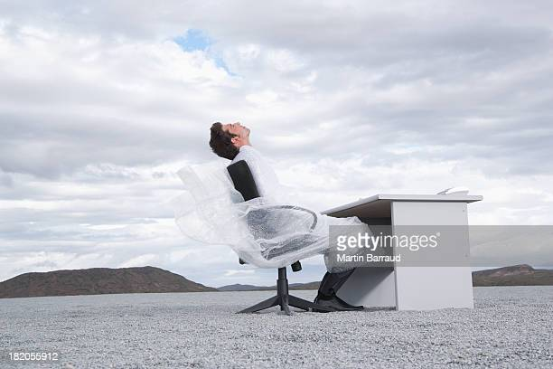 man outdoors wrapped in a sheer sheet - man tied to chair stock photos and pictures