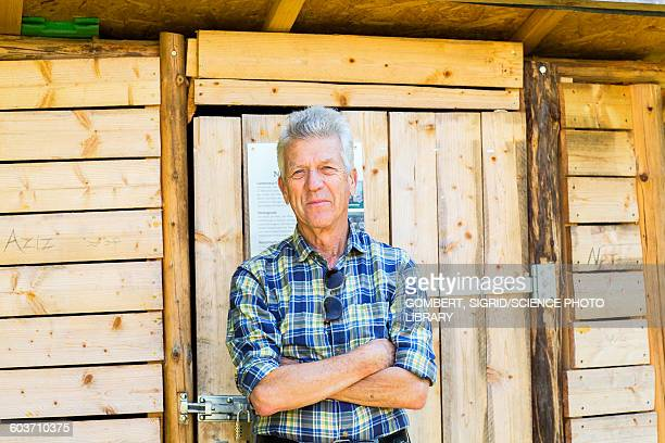 man outside garden shed - sigrid gombert stock pictures, royalty-free photos & images