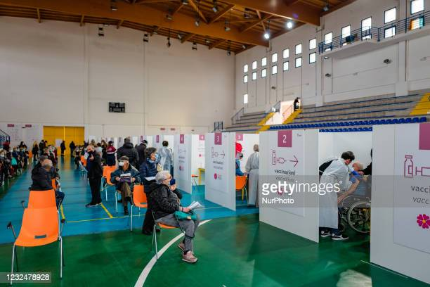 Man over 70 during the vaccination in the box while other people are waiting, on the first day of opening of the Palachicoli in Terlizzi on 23 April...