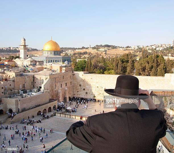 Man overlooking religion site.