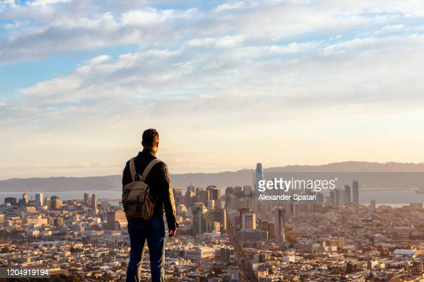 man overlooking san francisco skyline from above during sunrise, san francisco, california, usa - california stock pictures, royalty-free photos & images