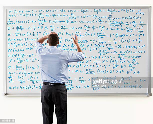 Man Overwhelmed In Front Of Large Math Problem