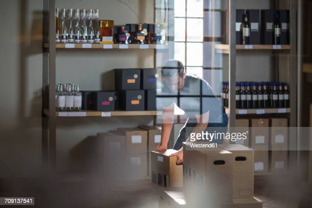 Man packing bottles of wine in shop