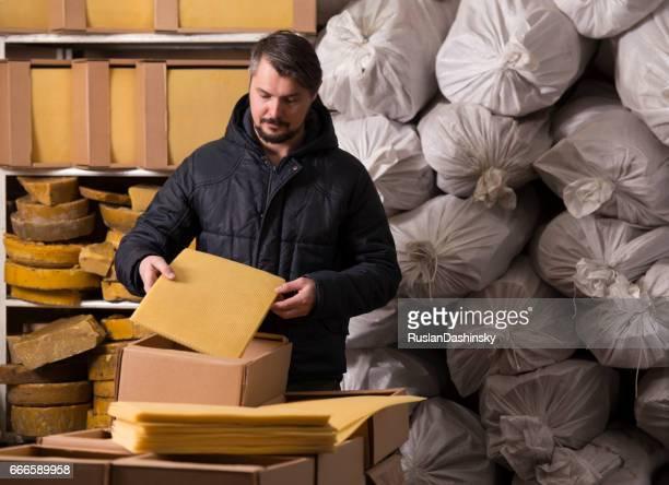 Man packing honeycomb sheets.