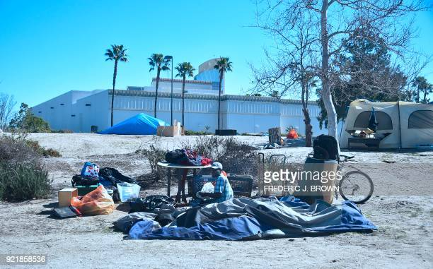 A man packs his belongings at a homeless encampment beside the Santa Ana River on February 20 2018 in Anaheim California Officials in Orange County...