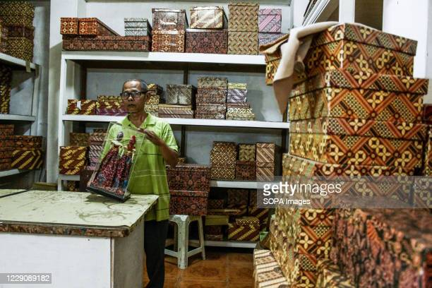 A man packs puppets in Cupumanik Gallery Cupumanik Puppets Gallery which was founded in 1970 has exported puppets various sizes and shapes for...