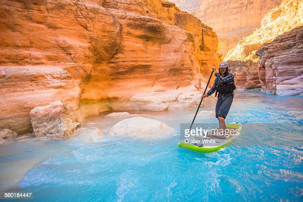 Man paddle boarding in Havasu Creek.
