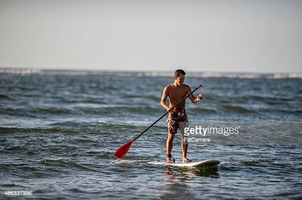Man Paddleboarding in Hawaii