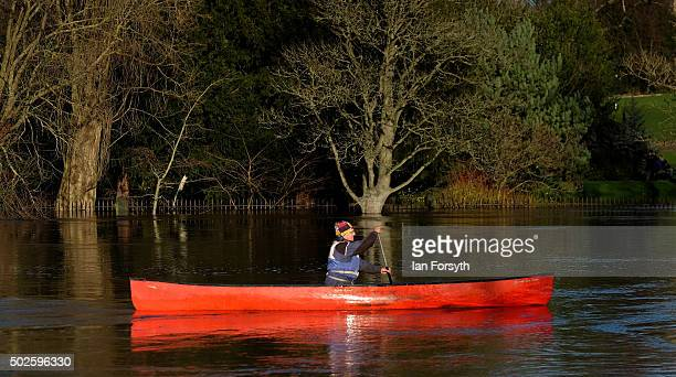 A man paddles a canoe along the River Ouse on December 27 2015 in York England Heavy rain over the Christmas period has caused further severe...