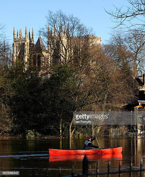 A man paddles a canoe along the River Ouse past York Minster on December 27 2015 in York England Heavy rain over the Christmas period has caused...