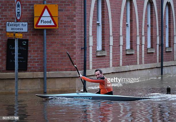 A man paddles his kayak along a flooded street on December 27 2015 in York England Heavy rain over the Christmas period has caused severe flooding in...