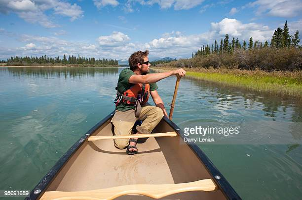 man paddling canoe on Yukon River