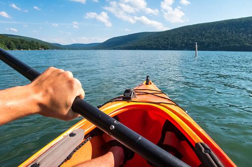 POV of man paddling in kayak on Skaneateles Lake, Skaneateles, New York State, USA - gettyimageskorea
