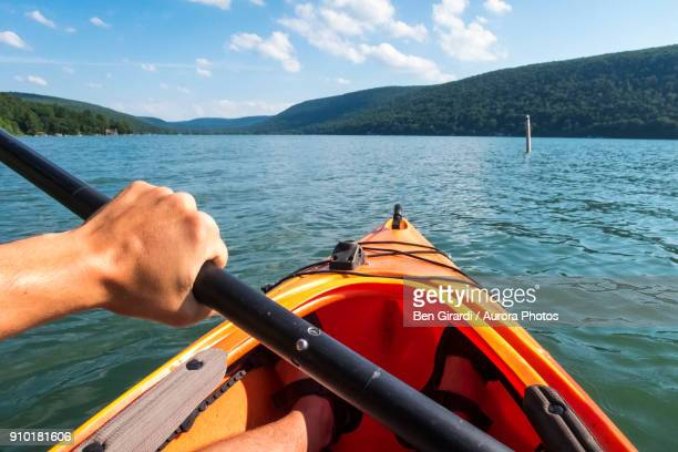 POV of man paddling in kayak on Skaneateles Lake, Skaneateles, New York State, USA