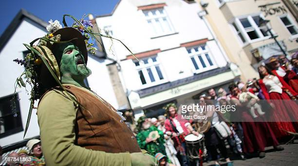 A man painted green takes part in a Beltane May Day celebration in Glastonbury main street on May 1 2013 in Glastonbury England Although more...
