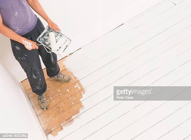 man painted into corner - clumsy stockfoto's en -beelden