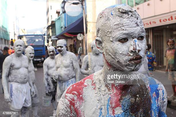 A man painted with mud during the beginning of the Carnival on March 04 2014 in Port Os Spain Trinidad The Carnival begins with revellers parading...