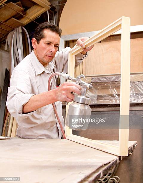 Man painting a frame