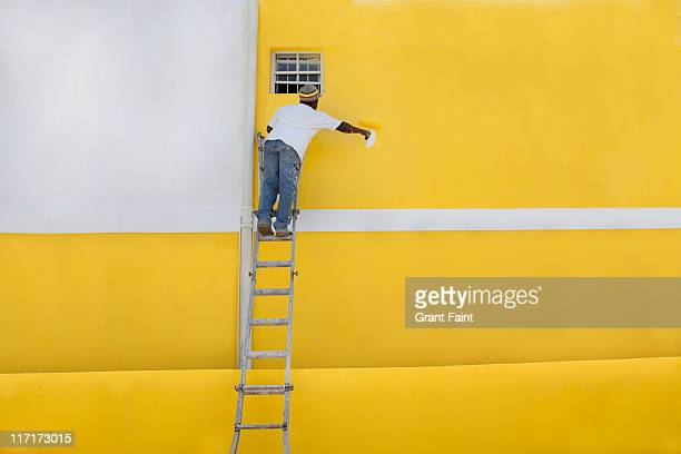 Man painting a house.